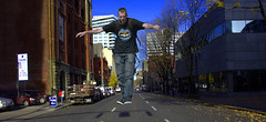 Levitation (swong95765) Tags: guy man levitating suspended street city air midair trick illusion jump