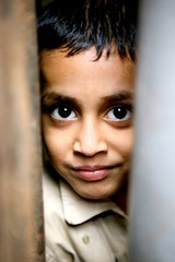 brother of the girl in red dress - portrait eyes galleria travel boy phitar bangladesh dhaka girl brother red dress