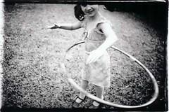 hula2 (Laura Burlton - www.lauraburlton.com) Tags: park girls girl childhood vintage children holga lomo artist play fineart memories skirt retro nostalgia memory littlepeople goodtime texa lauraburlton beingamom houstonchildrensphotographer runningjumpingplaying