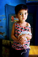 nepalese girl with her pet rat (phitar) Tags: travel 2002 nepal portrait pet girl rat asia kathmandu topf100 antiphoto galleria phitar abigfave
