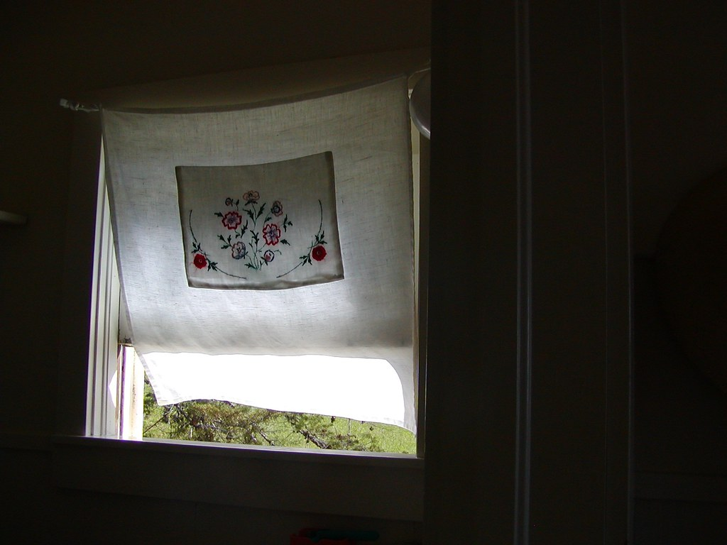 linen curtain blowing in window