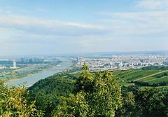 "Vienna vineyards, and the ""Blue Danube"" (monika & manfred) Tags: vienna bridge sky green water clouds river landscape austria cityscape wine vineyards mm danube riverdanube greenbluewhite utataview"
