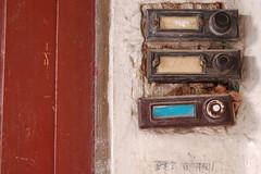 bucharest doorbells (chirgy) Tags: door abstract buttons plaster romania bucharest doorbells cotcbestof2006
