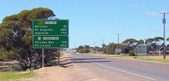 The junction of the Eyre and Flinders Highways. (yewenyi) Tags: road vacation sky holiday tree sign geotagged 1 highway alt australia junction highway1 adelaide intersection a1 sa caravan roadside aus telephonepoles distance southaustralia 402 km alternative 91 108 ceduna oceania streakybay 772 portlincoln 465 auspctagged national1 portaugusta b100 pctagged eyrehighway pc5690 ptlincoln geo:lat=32125907 geo:lon=133730736 flindershighway alt1 wirrulla ptaugusta
