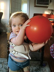 Playing Ball in Her Stander (Light Saver) Tags: circle toddler tn blueeyes vanderbilt anastasia waverly tennesee specialneeds spinabifida donotcopy fetalsurgery donotusewithoutwrittenpermissions allmyimagesarecopyrighted ignoranceofcopyrightlawsisnoexcusetobreakthem allimagesarelicensedthroughgettyimages contactmewithanyquestions