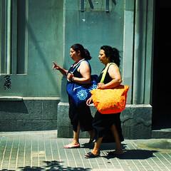 Headed for Barcelonetta (moriza) Tags: barcelona travel ladies people orange bag walking lumix spain bcn sunny mo mohammad moriza riza xiampe modomatic