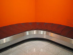 travel curve (Desideria) Tags: orange beautiful silver germany grey airport cool interesting grau fv5 fv10 flughafen minimalism curve dsseldorf mondrian baggageclaim kurve silbern favview5 fernweh minimalismus favview10 gepcklaufband