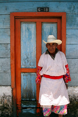 Traditional Maya Traje in San Martn Sacatepquez, Guatemala (Bryan-Long-Photography) Tags: world old travel red people man texture tourism colors wearing america mesoamerica belt hand maya vibrant guatemala central tourists backpacking elderly mayan backpack indians woven cloth traje indigenous guatemalan centroamerica mayans indigneous dwwg