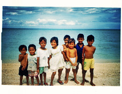 Kids on the Beach (moriza) Tags: travel film print indonesia island interestingness 100v10f mo scanned mohammad moriza riza makassar samalona blackribbonicon notlaelae modomatic
