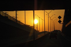 Coming through a tunnel to see the rising sun (Saveena (AKA LHDugger)) Tags: road morning sky 15fav favorite cloud sun sunrise dawn all texas no houston lisa tunnel august 2006 any september h rights westpark commute form written myfavorite without usage reserved allowed consent dugger saveena  top20texas saveena
