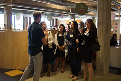 Attendees at Inside the CEO Mind tour Skidmore Studio inside Detroit's M@dison Building.