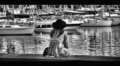 One day ! (CJS*64) Tags: barcelona people bw holiday monochrome hat boats mono boat blackwhite spain nikon women sitting candid watching catalonia sit sat nikkor cjs whiteblack nikkorlens nikond7000 18mm105mmlens craigsunter cjs64