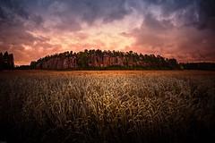 Harvest Rock (Mika Latokartano) Tags: autumn clouds finland cliffs rockface september