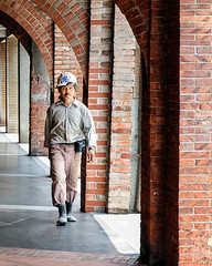 Bopilao (Anne Clements) Tags: red man brick walking helmet taiwan worker taipei taiwanese monga striding japanesearchitecture bopiliao anneclements