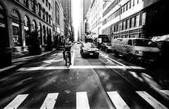 (christait) Tags: road street city nyc newyorkcity usa newyork cars film bike reflections cyclist traffic grain ilforddelta3200 leicam3