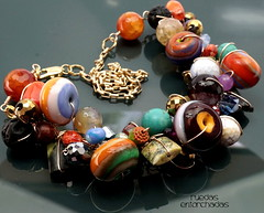 Ruedas Entorchadas Necklace (Laura Blanck Openstudio) Tags: show blue urban orange usa abstract black green art glass lines coral festival gold golden necklace beads big wire shiny colorful aqua artist purple handmade stones eggplant turquoise contemporary stripes fine gray tubes arts violet ivory plum dramatic funky jewelry semi made odd earthy precious donut round bracelet winner cylinder periwinkle chic transparent murano rare lampwork beaded multicolor artisan pendant bold whimsical openstudio asymmetric openstudiobeads