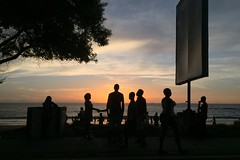 People gather at sunset on Lumley Beach, in Freetown, Sierra Leone