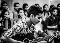 The Guitarist (SandmaxPrime) Tags: people blackandwhite music white black college students monochrome contrast 50mm university guitar events 18 drama guitarist mumbaiuniversity udit 2014 nikon50mm nikond5000