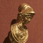 Roman gold pectoral with relief representations of Jupiter, Juno and Minerva: detail of Minerva thumbnail