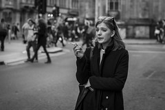 Cigarette Holder (Leanne Boulton) Tags: monochrome urban street candid portrait portraiture streetphotography candidstreetphotography candidportrait streetlife isolation woman female pretty girl face facial expression beauty beautiful look emotion feeling atmosphere mood smoke smoker smoking cigarette tone texture detail depthoffield bokeh natural outdoor light shade shadow city scene human life living humanity people society culture canon 5d canon5dmkiii 70mm character ef2470mmf28liiusm black white blackwhite bw mono blackandwhite glasgow scotland uk