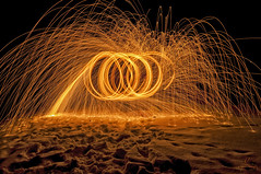 Night Bright (Quincey Deters) Tags: 2016 allrightsreserved canada january nature outdoor winter ©quinceydeters northamerica canadianrockymountains jasper jaspernationalpark snow evening night alberta fire steelwool spark spinning gold orange horizontal colourimage lowkey lowlight abstract