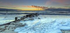 Mind Your Feet (nicklucas2) Tags: mudeford sun sunrise solent wave sea pebble needles lighthouse isleofwight avonbeach groyne