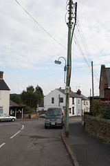 Steel electricity distribution post with street lamp attached - Nether Heage, Derbyshire, September 2015 (mikeyashworth) Tags: derbyshire september2015 netherheage streetlamp streetlighting electricitydistributionpole steelpole mikeashworthcollection
