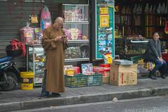 Modern Monk, Shanghai (Snappy_Snaps) Tags: china urban temple shanghai citylife monk jadebuddhatemple buddhistmonk