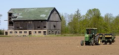 Active farm with abandoned old barn, Halton Hills, Ontario. (edk7) Tags: nikond300 edk7 2009 canada ontario haltonregion haltonhills farm barn abandoned ruin dilapidated old field tractor seeder implement johndeere architecture building oldstructure country countryside rural vehicle gambrelroofline sigma50500mm1463apodghsmex