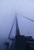 Foggy morning bridge (Jorn van Maanen) Tags: erasmusbrug rotterdam maas blue tramcar fog partly hidden
