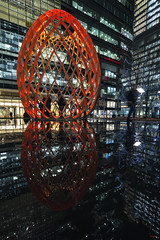 OVO at Canary Wharf's Winter Lights 2017 (Waving lights in the dark) Tags: 2017 london canarywharf ovo lightart installation winterlights winter lights reflection reflect water art dynamic sculpture golden proportion goldenproportion spiral pairs crossed red surrounded universe cyclical scenography city night nightphotography afterdark movement