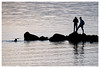 Guess what happened... (HereInVancouver) Tags: englishbay ocean pacific water rocks balance swimming winter cold vancouver bc canada candid thingstodobythewater framed canong3 ngc