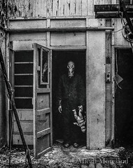 Daddie's Home (micahmoreland) Tags: creepy horror surreal surrealism surrealist conceptual costume world war 2 ii dystopian scary haunting grunge texture male toxic death gas mask baby doll child urbex abandoned machine shop urban exploration monochrome black white