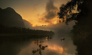 Fishermen at sunrise. Xing Ping