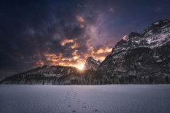 Fire and Ice (Manuel.Martin_72) Tags: glarus swissalps switzerland darkness darkmood drama enchanting fairytale lightdrama magic forest mountainpeaks mountains rocks stones trees woods frozen ice lake snow clouds cloudy glow sunrise klöntal ch