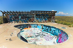 Graffiti Pool (BlueShift 12) Tags: arizona sky southwest art abandoned grass concrete graffiti route66 paint vandalism ghosttown decrepit destroyed americansouthwest twoguns