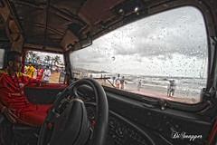 Baga beach_HDR2 (Ganugapenta NaveenKumar Reddy) Tags: sea india clouds canon watch goa monsoon 7d lifegaurd hdr darkclouds bagabeach opteka canon7d opteka65mm mahindrathar