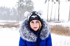 Katya (ivan_volchek) Tags: girl portrait snow cap eyes face jacket fur blue lips beautifulgirl forest trees christmastree pine trosnik bokeh