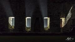 The Search Party Draws Near (Tim van Zundert) Tags: harlech castle gwynedd merionethshire north west wales night evening long exposure stone wall window light shafts sony a7r voigtlander 21mm ultron