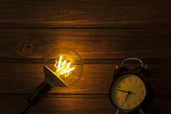 clock electric background (Antonio MalaMente) Tags: apple background wood lightbulb black bulb idea light edison table lamp incandescent vintage dark wooden bright power electric electricity floor retro filament glow art old space tungsten