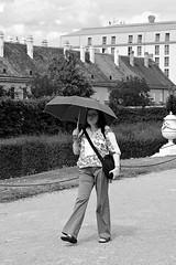 Walk with sandals, socks and umbrella (Franco & Lia) Tags: street fotografiadistrada photographiederue vienna wien austria österreich biancoenero blackandwhite noiretblanc 2485f284 umbrella