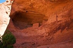 Shadow vs. Light, Heat vs. Cool, Natural vs. Man-made (Herculeus.) Tags: antiquity aptcondo archeologicalsite bouldersstonerocks brickblockwalls buildings cliffs country day desert erosion evergreens fall landscape monumentvalley nativeamerican navaho navahonation outdoor outdoors outside pueblo residential scrub shade trees ut valley walls westus16 architectureinpixels 5photosaday