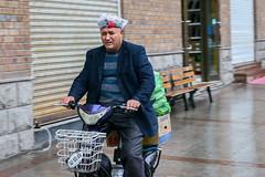 Rainy day in Urumqi (inchiki tour) Tags: street travel people snapshot uighur xinjiang silkroad  uyghur traveling centralasia   urumqi   2015      doppa