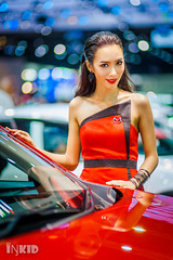 DSC04039 (inkid) Tags: red portrait people reflection girl lady female thailand prime lights model women pretty dof bokeh f14 85mm sigma indoor thai ambient mazda hsm motorexpo2015