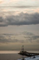 lighthouse with Denmark on the horizon (Mange J) Tags: ocean sea sky lighthouse snow water weather denmark pier skåne pentax sweden sound sverige malmö latter öresund pentaxart magnusjakobsson k5ii