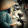 DSC_2027 (Kent MacElwee) Tags: vietnam sea asia southeastasia hoian centralvietnam oldquarter fish hat conicalhat vendor vespa motorbike rickshaw rain