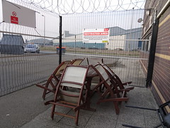 No interruptions (stevenbrandist) Tags: patio liverpool portofliverpool table chairs nosmoking wooden furniture merseyside secure fence barbedwire