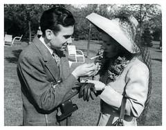 Perfect Gentleman (vintagesmoke) Tags: vintage snapshot monochrome man woman smoking cigarette light hat couple black white 1942