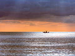 An Amazing Ride (dshoning) Tags: ocean boat sky clouds sunset rays glistening florida
