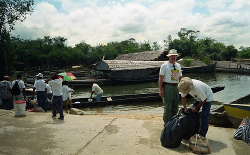 Wrapping knapsacks in plastic before the river trip Puerto Ayacucho